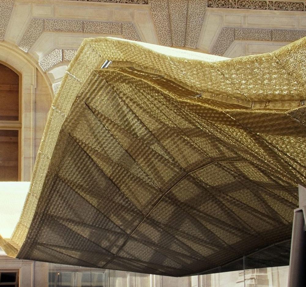 The magnificent undulating glass roof of the Département des Arts de l'Islam - © Musée du Louvre